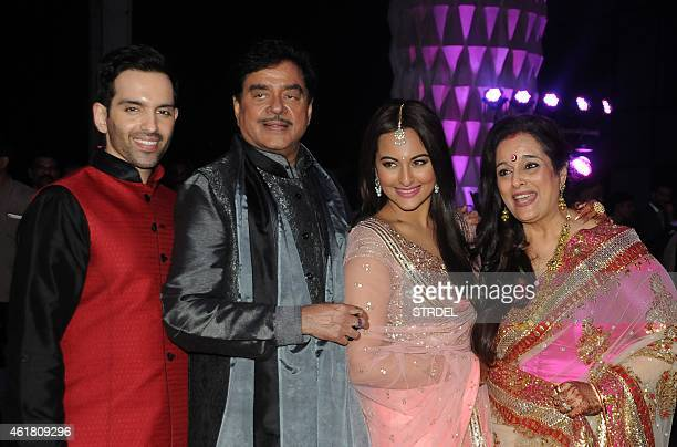 Indian Bollywood veteran actor Shatrughan Sinha with his wife Poonam pose with their children daughter Sonakshi Sinha and son Luv during the wedding...