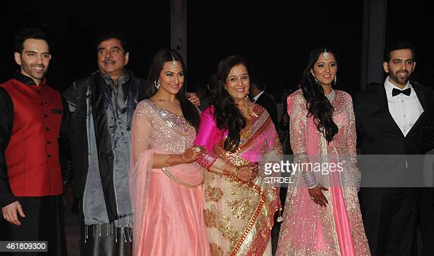 Indian Bollywood veteran actor Shatrughan Sinha with his wife Poonam pose with children Luv Sonakshi and newlyweds Kussh and Taruna Agarwal during...