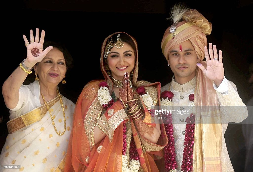 Indian Bollywood veteran actress <a gi-track='captionPersonalityLinkClicked' href=/galleries/search?phrase=Sharmila+Tagore&family=editorial&specificpeople=2523120 ng-click='$event.stopPropagation()'>Sharmila Tagore</a> (L) poses during the wedding of <a gi-track='captionPersonalityLinkClicked' href=/galleries/search?phrase=Soha+Ali+Khan&family=editorial&specificpeople=691303 ng-click='$event.stopPropagation()'>Soha Ali Khan</a> (C) and Kunal Khemu (R) in Mumbai on January 25, 2015.