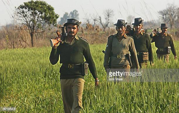 Indian Border Security constables patrol along the International Border where a fence seperating India and Pakistan is being built on February 25...