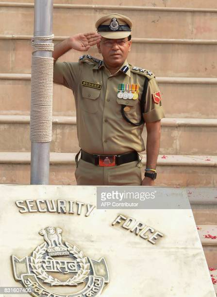 Indian Border Security Force Commandant Sudeep salute during a ceremony to celebrate India's Independence Day at the IndiaPakistan Wagah border post...