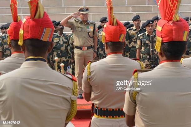 Indian Border Security Force Commandant Sudeep salutes during a ceremony to celebrate India's Independence Day at the IndiaPakistan Wagah border post...