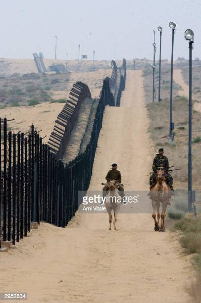 Indian Border Security Force constables on camel back patrol the border with Pakistan February 8 2004 in Tanot India The 470kilometre desert border...