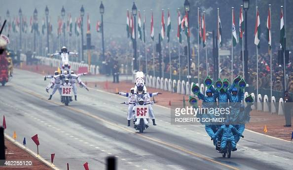Indian Border Security Force motorcycle specialists perform during the Indian Republic Day parade in New Delhi on January 26 2015 Rain failed to...