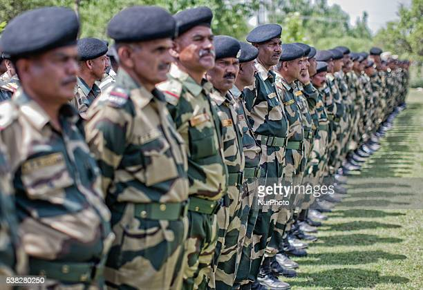 Indian Border Security Force officers stand in respect next to the coffins containing the bodies of their killed soldiers during wreathlaying...