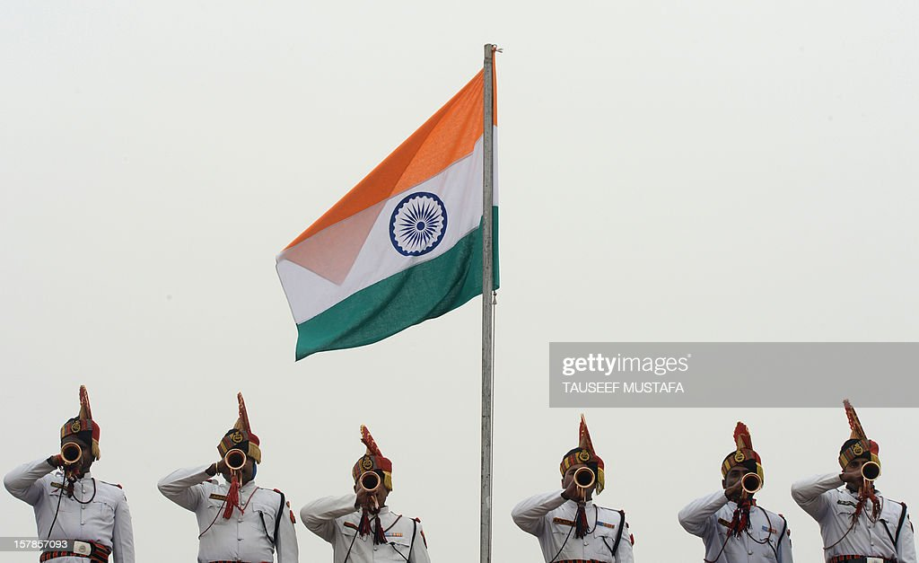 Indian Border Security Force personnel blow bugles during a passing out parade for new rectruits in Humhama on the outskirts of Srinagar on December...