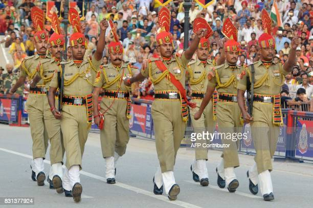 Indian Border Security Force personnel march during the daily beating of the retreat ceremony at the IndiaPakistan Wagah Border Post some 35kms west...