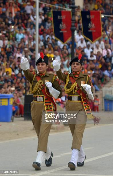 Indian Border Security Force personnel march past during the daily beating of the retreat ceremony on the IndiaPakistan Border at Wagah on February...