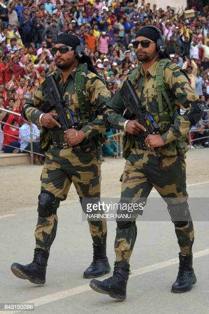 Indian Border Security Force personnel patrol during the daily beating of the retreat ceremony on the IndiaPakistan Border at Wagah on February 20...