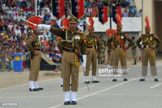 Indian Border Security Force personnel perform during the daily beating of the retreat ceremony on the IndiaPakistan Border at Wagah on February 20...