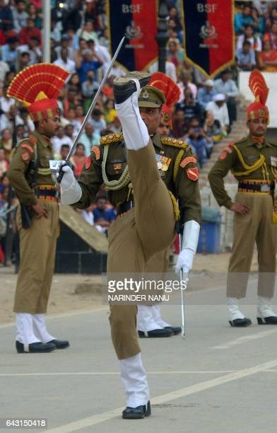 Indian Border Security Force personnel perform during the daily beating of the retreat ceremony at the IndiaPakistan Wagah Border on February 202017...