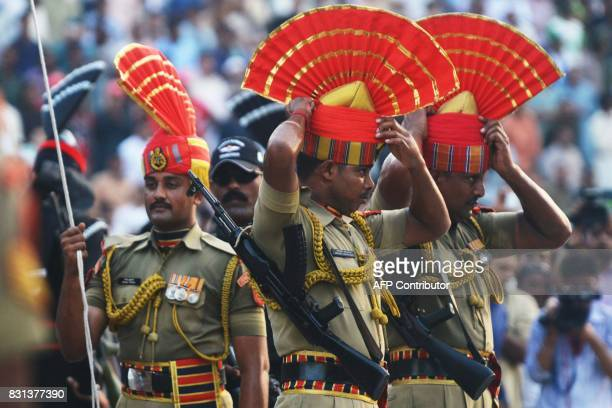 Indian Border Security Force personnel perform the flag off ceremony during the daily beating of the retreat ceremony at the IndiaPakistan Wagah...