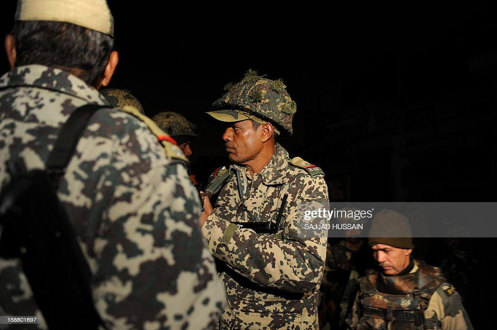 Indian Border Security Force Personnel (BSF) stand guard outside the residence of an Indian gang-rape victim in New Delhi on December 30, 2012. The body of a gang-rape victim arrived back in New Delhi on December 30 after her death from sickening injuries in a Singapore hospital as India was engulfed by a mass outpouring of grief and anger.