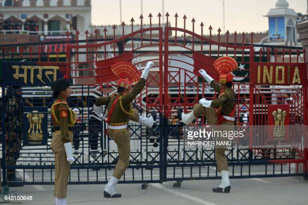 Indian Border Security Force personnel symbolically slam gates shut as they perform during the daily beating of the retreat ceremony on the...