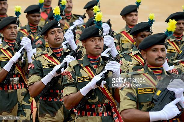 Indian Border Security Force personnel take part in a Republic Day parade held at the Manek Shaw Parade Grounds in Bangalore on January 26 2017 India...