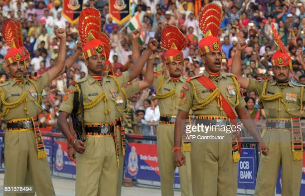 Indian Border Security Force personnel take part in the daily beating of the retreat ceremony at the IndiaPakistan Wagah Border Post some 35kms west...