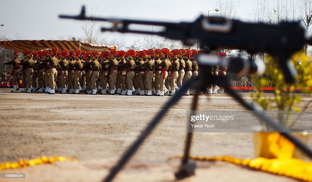 Indian Border Security Force (BSF) soldier march during their passing out parade on November 24, 2012 in Humhama, on the outskirts of Srinagar, the summer capital of Indian administered Kashmir, India. 545 new trained recruits of the Indian paramilitary Border Security Force constables took oaths during their passing out parade after successfully completing 36 weeks of basic training which involved physical fitness, weapons handling, map reading, counter-insurgency operations and human rights. The recruits will join Indian soldiers to fight militants in Kashmir, a spokesman of the paramilitary BSF said. India has already close to a million soldiers posted in Jammu and Kashmir, making the disputed Himalayan region one of the most militarized zone in the world