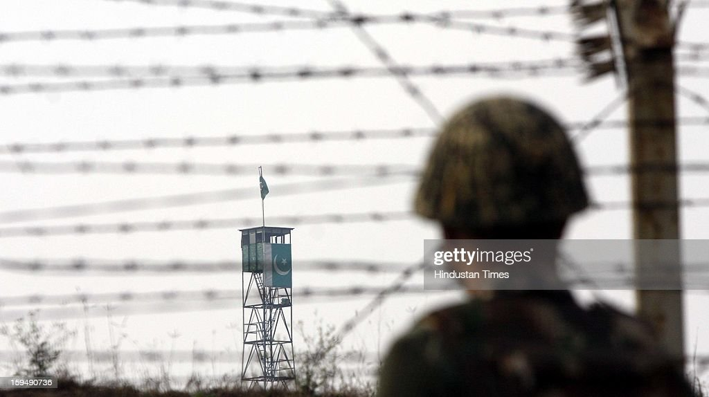 Indian Border Security Force (BSF) soldier stands guard during a patrol near international border fencing at Suchet Garh in Ranbir Singh Pura on January 14, 2013 about 27 kilometers from Jammu, India. A Flag meeting was held between the Pakistani and Indian army commanders at LoC at the Chakan Da Bagh, in Poonch, 245 kilometers from Jammu to defuse the tension which escalated after Pakistani troops killed two Indian soldiers.