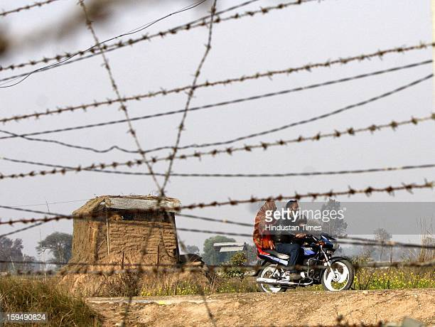 Indian Border Security Force soldier stands guard during a patrol near international border fencing at Suchet Garh in Ranbir Singh Pura on January 14...