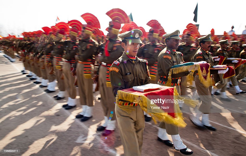 Indian Border Security Force (BSF) soldiers carry Indian national flags for the new during a passing out ceremony on November 24, 2012 in Humhama, on the outskirts of Srinagar, the summer capital of Indian administered Kashmir, India. 545 new trained recruits of the Indian paramilitary Border Security Force constables took oaths during their passing out parade after successfully completing 36 weeks of basic training which involved physical fitness, weapons handling, map reading, counter-insurgency operations and human rights. The recruits will join Indian soldiers to fight militants in Kashmir, a spokesman of the paramilitary BSF said. India has already close to a million soldiers posted in Jammu and Kashmir, making the disputed Himalayan region one of the most militarized zone in the world