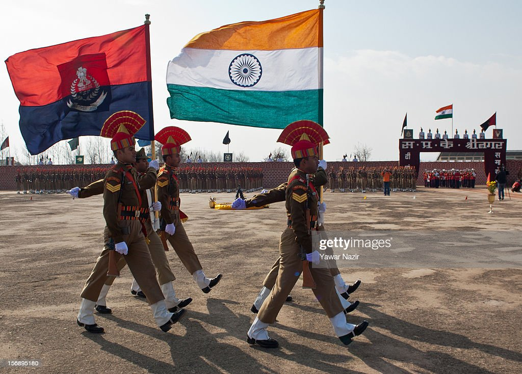 Indian Border Security Force (BSF) soldiers carry their flag during their passing out parade on November 24, 2012 in Humhama, on the outskirts of Srinagar, the summer capital of Indian administered Kashmir, India. 545 new trained recruits of the Indian paramilitary Border Security Force constables took oaths during their passing out parade after successfully completing 36 weeks of basic training which involved physical fitness, weapons handling, map reading, counter-insurgency operations and human rights. The recruits will join Indian soldiers to fight militants in Kashmir, a spokesman of the paramilitary BSF said. India has already close to a million soldiers posted in Jammu and Kashmir, making the disputed Himalayan region one of the most militarized zone in the world
