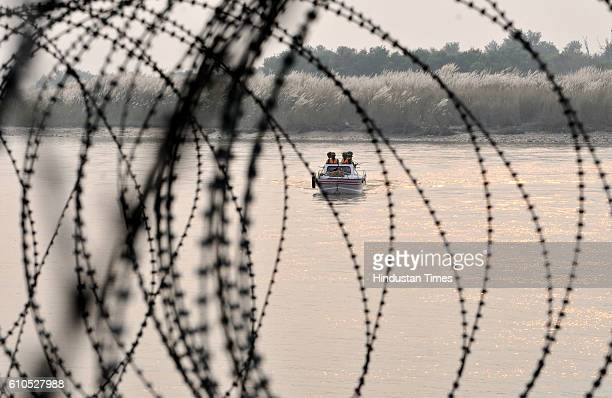Indian Border Security Force soldiers coming back to their post after patrolling on a boat in Out Post Chenab along the Pargwal area of IndiaPakistan...