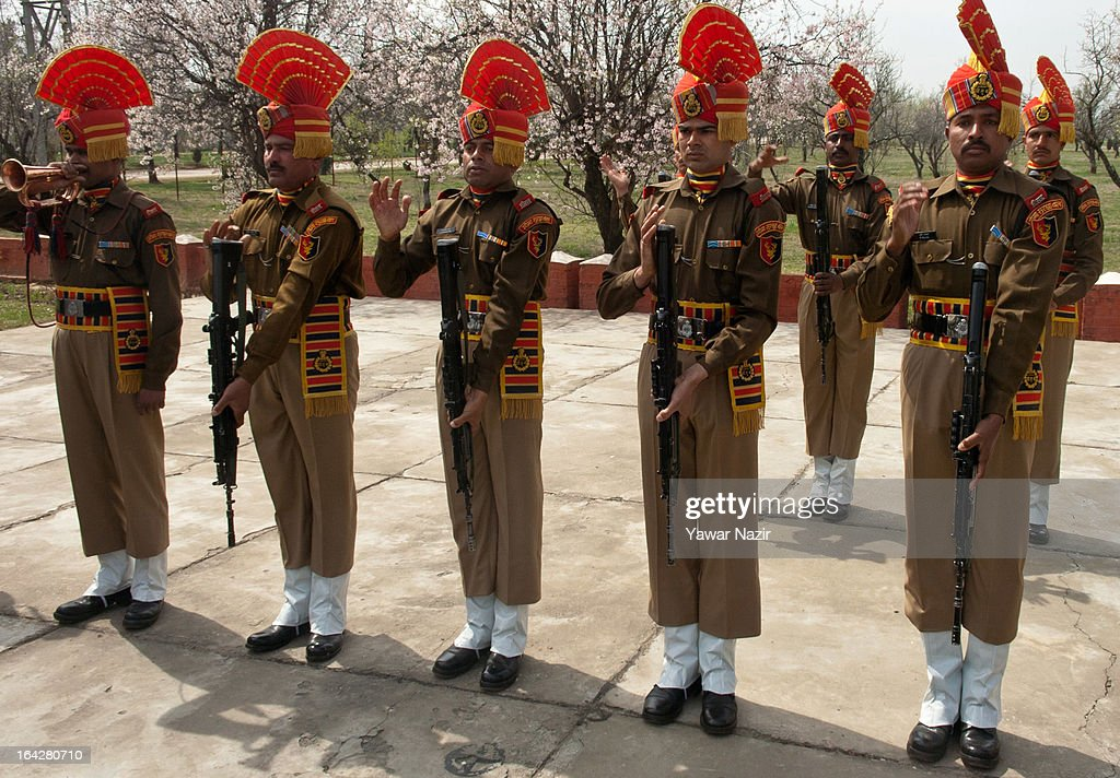 Indian Border Security Force (BSF) soldiers hold their rifles down during a wreath-laying ceremony of their killed comrade, Krishna Kalita, on March 22, 2013 in Srinagar, the summer capital of Indian administered Kashmir, India. A wreath-laying ceremony was held by the BSF for their killed comrade after suspected rebels shot him dead yesterday and wounded two others when they fired on their vehicle on a highway. Kashmir valley is on the alert since the hanging of Afzal Guru, a local resident who was convicted of carrying out a deadly attack on the Indian Parliament in 2001.