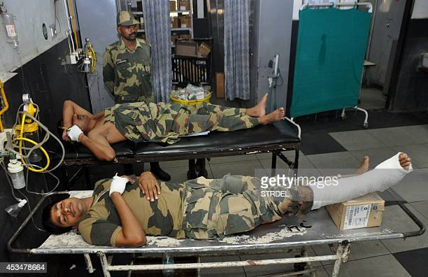 Indian Border Security Force soldiers injured in crossborder firing undergo treatment at the Government Medical College Hospital in Jammu on August...