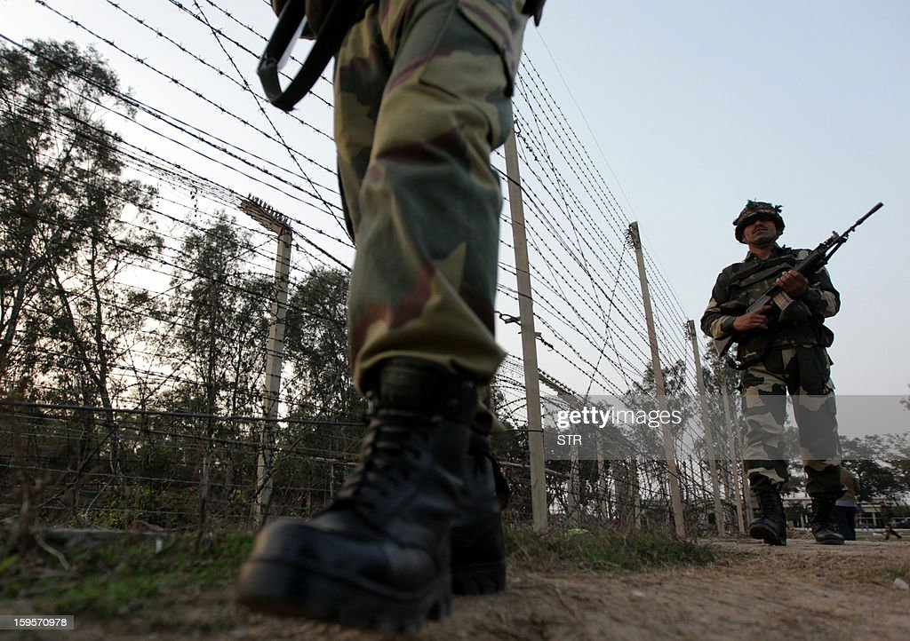 Indian Border Security Force (BSF) soldiers patrol along the border fence on the India-Pakistan border at Suchet Garh in Ranbir Singh Pura, about 36 kms from Jammu on January 16, 2013. India's army has reached an 'understanding' with Pakistan to 'de-escalate' military tensions in Kashmir after a recent deadly flare-up in the disputed border region, a military spokesman told AFP.