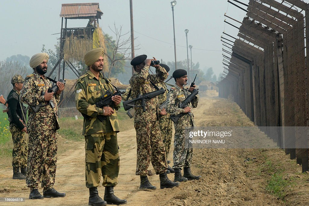 Indian Border Security Force soldiers patrol along the India-Pakistan border fence about 27 kms from Wagah on January 13, 2013. The beheading of an Indian soldier may have sparked a war of words between Delhi and Islamabad but the two nuclear rivals are both determined to prevent it from wrecking a fragile peace process. Two Indian soldiers died after a firefight erupted in disputed Kashmir on Tuesday as a patrol moving in fog discovered Pakistani troops about 500 metres (yards) inside Indian territory, according to the Indian army. AFP PHOTO/NARINDER NANU