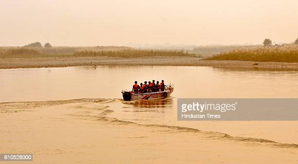 Indian Border Security Force soldiers patrol on a boat in Out Post Chenab along the Pargwal area of IndiaPakistan International Border on September...