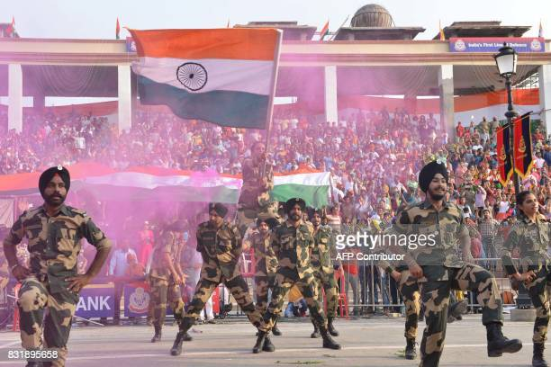 Indian Border Security Force soldiers perform the Punjabi dance the Bhangra during a ceremony to mark India's 70th Independence Day celebrations at...