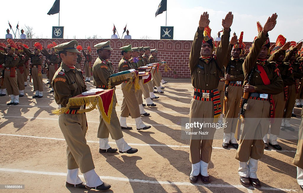 Indian Border Security Force (BSF) soldiers raise their hands as they take oaths during their passing out parade on November 24, 2012 in Humhama, on the outskirts of Srinagar, the summer capital of Indian administered Kashmir, India. 545 new trained recruits of the Indian paramilitary Border Security Force constables took oaths during their passing out parade after successfully completing 36 weeks of basic training which involved physical fitness, weapons handling, map reading, counter-insurgency operations and human rights. The recruits will join Indian soldiers to fight militants in Kashmir, a spokesman of the paramilitary BSF said. India has already close to a million soldiers posted in Jammu and Kashmir, making the disputed Himalayan region one of the most militarized zone in the world