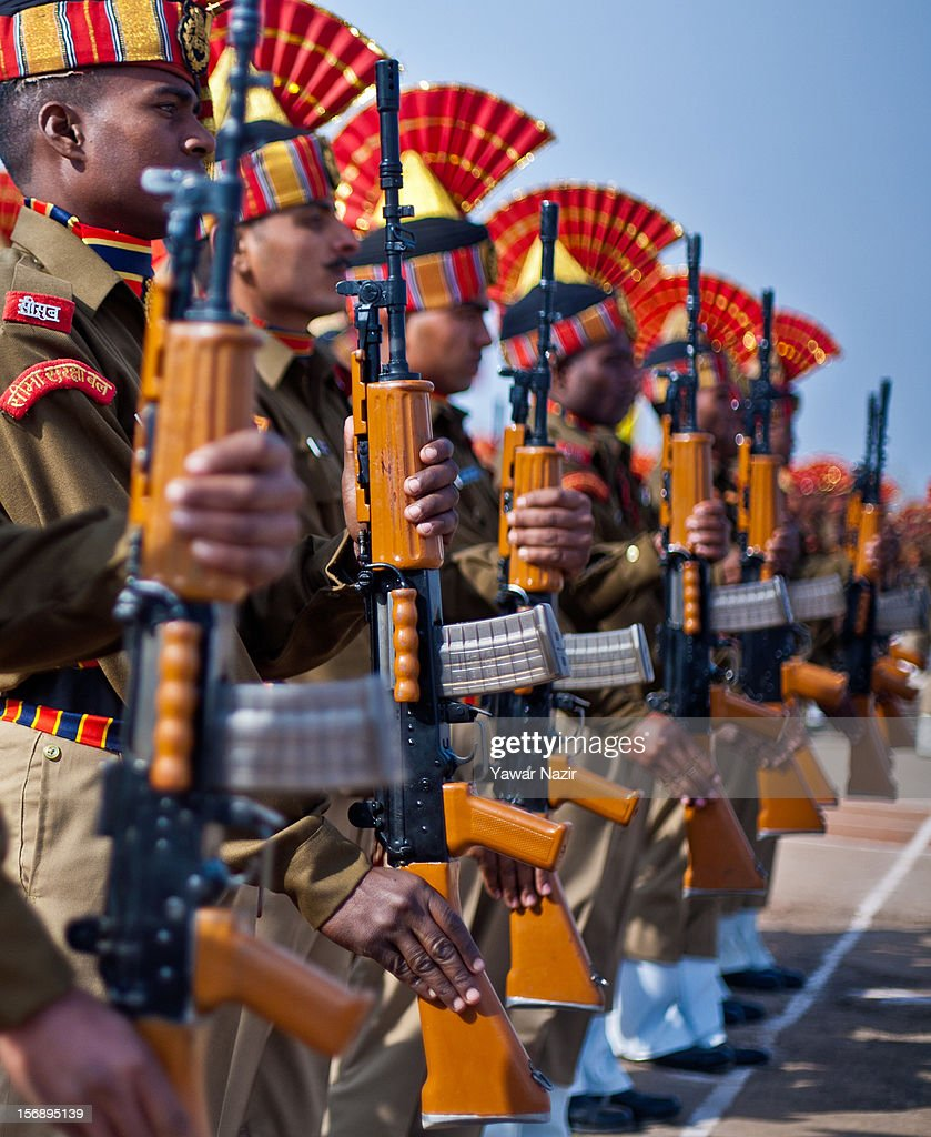Indian Border Security Force (BSF) soldiers raise their rifles as they salute during their passing out parade on November 24, 2012 in Humhama, on the outskirts of Srinagar, the summer capital of Indian administered Kashmir, India. 545 new trained recruits of the Indian paramilitary Border Security Force constables took oaths during their passing out parade after successfully completing 36 weeks of basic training which involved physical fitness, weapons handling, map reading, counter-insurgency operations and human rights. The recruits will join Indian soldiers to fight militants in Kashmir, a spokesman of the paramilitary BSF said. India has already close to a million soldiers posted in Jammu and Kashmir, making the disputed Himalayan region one of the most militarized zone in the world