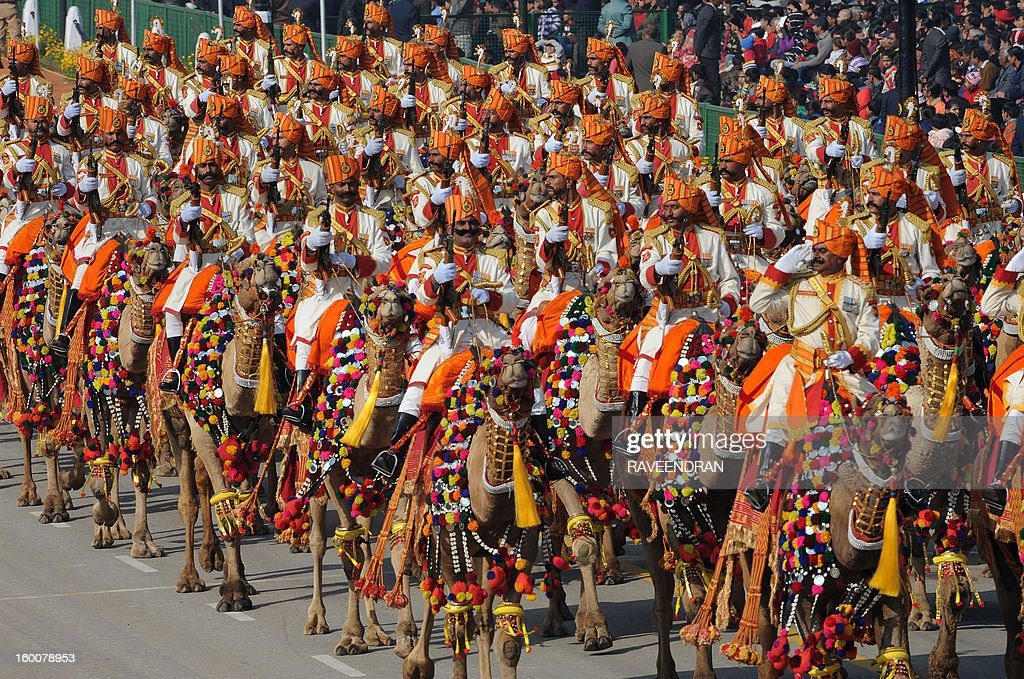 Indian Border Security Force (BSF) soldiers ride camels down the ceremonial boulevard Rajpath during the Republic Day parade in New Delhi on January 26, 2013. India marked its Republic Day with celebrations held under heavy security, especially in New Delhi where large areas were sealed off for an annual parade of military hardware at which Bhutan's king Jigme Khesar Namgyel Wangchuck was chief guest. AFP PHOTO/RAVEENDRAN