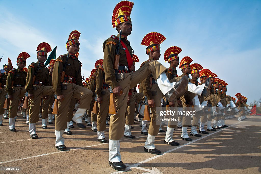 Indian Border Security Force (BSF) soldiers salute during their passing out parade on November 24, 2012 in Humhama, on the outskirts of Srinagar, the summer capital of Indian administered Kashmir, India. 545 new trained recruits of the Indian paramilitary Border Security Force constables took oaths during their passing out parade after successfully completing 36 weeks of basic training which involved physical fitness, weapons handling, map reading, counter-insurgency operations and human rights. The recruits will join Indian soldiers to fight militants in Kashmir, a spokesman of the paramilitary BSF said. India has already close to a million soldiers posted in Jammu and Kashmir, making the disputed Himalayan region one of the most militarized zone in the world