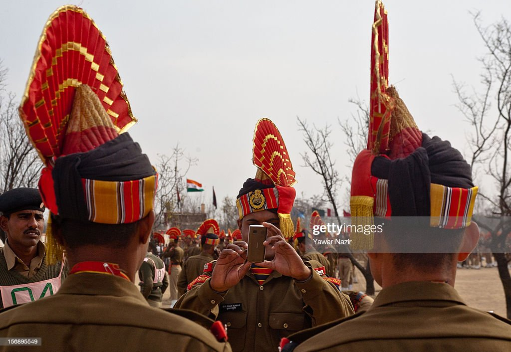 Indian Border Security Force (BSF) soldiers take photographs of each other before their passing out parade on November 24, 2012 in Humhama, on the outskirts of Srinagar, the summer capital of Indian administered Kashmir, India. 545 new trained recruits of the Indian paramilitary Border Security Force constables took oaths during their passing out parade after successfully completing 36 weeks of basic training which involved physical fitness, weapons handling, map reading, counter-insurgency operations and human rights. The recruits will join Indian soldiers to fight militants in Kashmir, a spokesman of the paramilitary BSF said. India has already close to a million soldiers posted in Jammu and Kashmir, making the disputed Himalayan region one of the most militarized zone in the world