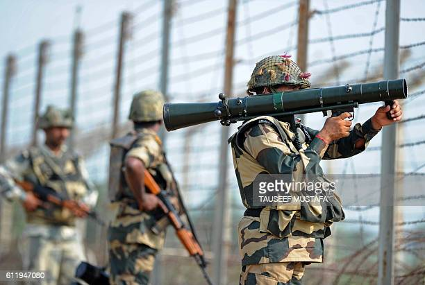 Indian Border Security Force soldiers take up positions at an outpost along a fence at the IndiaPakistan border in RS Pora southwest of Jammu on...