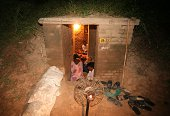 Indian border villagers take shelter in an Indian army bunker during alleged firing from the Pakistan side of the Line of Control during ongoing...