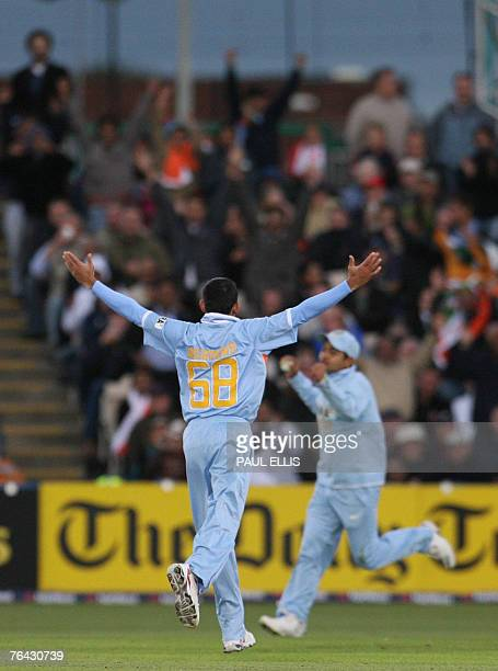 Indian bowler Ajit Agarkar celebrates as Piyush Chawla catches England batsman Kevin Pietersen during their One Day International cricket match at...