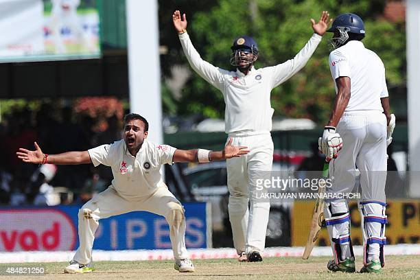 Indian bowler Amit Mishra and teammate Lokesh Rahul appeal during the third day of the second Test match between Sri Lanka and India at the P Sara...
