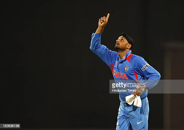 Indian bowler Harbhajan Singh celebrates after he took four wickets during the ICC T20 World Cup cricket match between India and England at R...