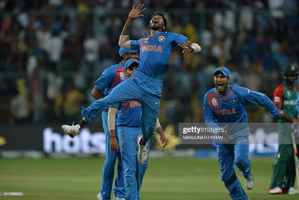 Indian bowler Hardik Pandya jumps to celebrate the wicket that led to the victory of India in the last ball by 2 runs during the World T20 cricket...