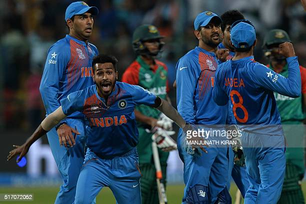 Indian bowler Hardik Pandyacelebrates the wicket that led to the victory of India in the last ball by 2 runs during the World T20 cricket tournament...