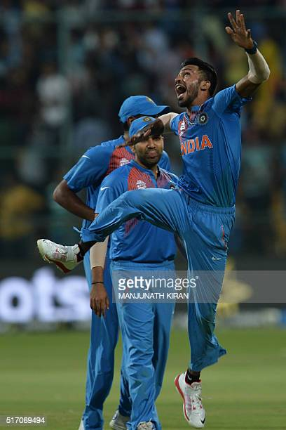 Indian bowler Hardik Pandyajumps to celebrate the wicket that led to the victory of India in the last ball by 2 runs during the World T20 cricket...