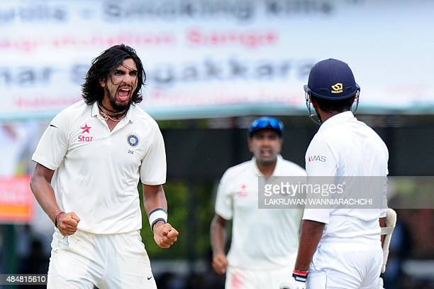 Indian bowler Ishant Sharma celebrates after taking the wicket of Sri Lankan cricketer Lahiru Thirimanne during the third day of the second Test...