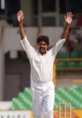 Indian bowler Kapil Dev raises his arms after taking his 400th test wicket during the fifth test against Australia in Perth 03 February 1992