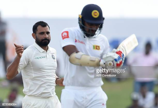 Indian bowler Mohammed Shami celebrates after dismissing Sri Lankan batsman Danushka Gunathilaka during the second day of the first Test match...
