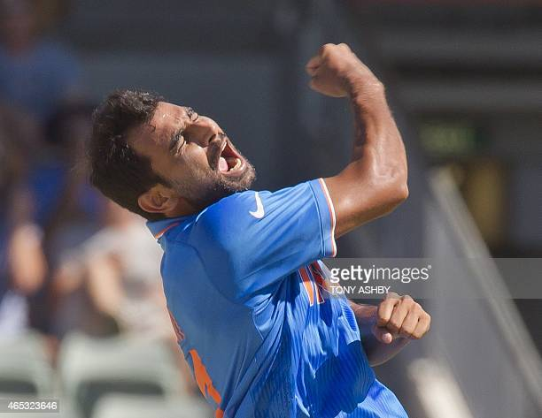 Indian bowler Mohammed Shami celebrates after taking the wicket of West Indies batsman Dwayne Smith during the 2015 Cricket World Cup Pool B match...
