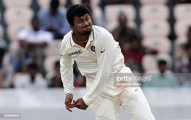 Indian bowler Pragyan Ojha bowls to a New Zealand batsman during second day of first test match between India Vs New Zealand at Rajiv Gandhi...